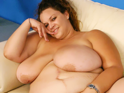 Gorgeous BBW Mona Mounds stripping off her clothes and rubbing her pussy for the camera